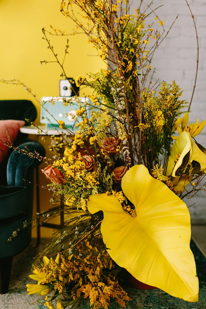 wes anderson inspired wedding brooklyn new york large floral arrangement