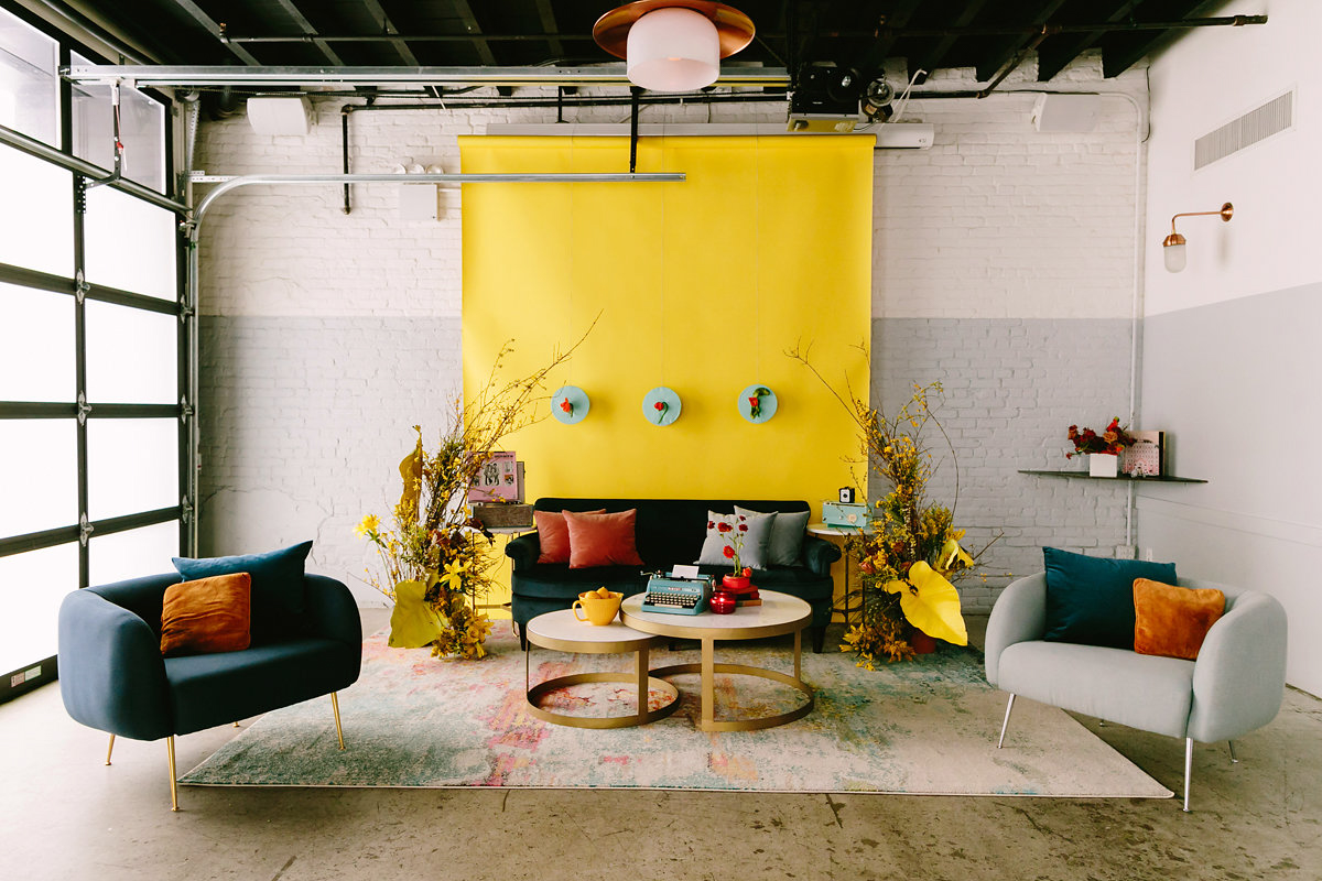 wes anderson inspired wedding brooklyn new york couches and yellow backdrop
