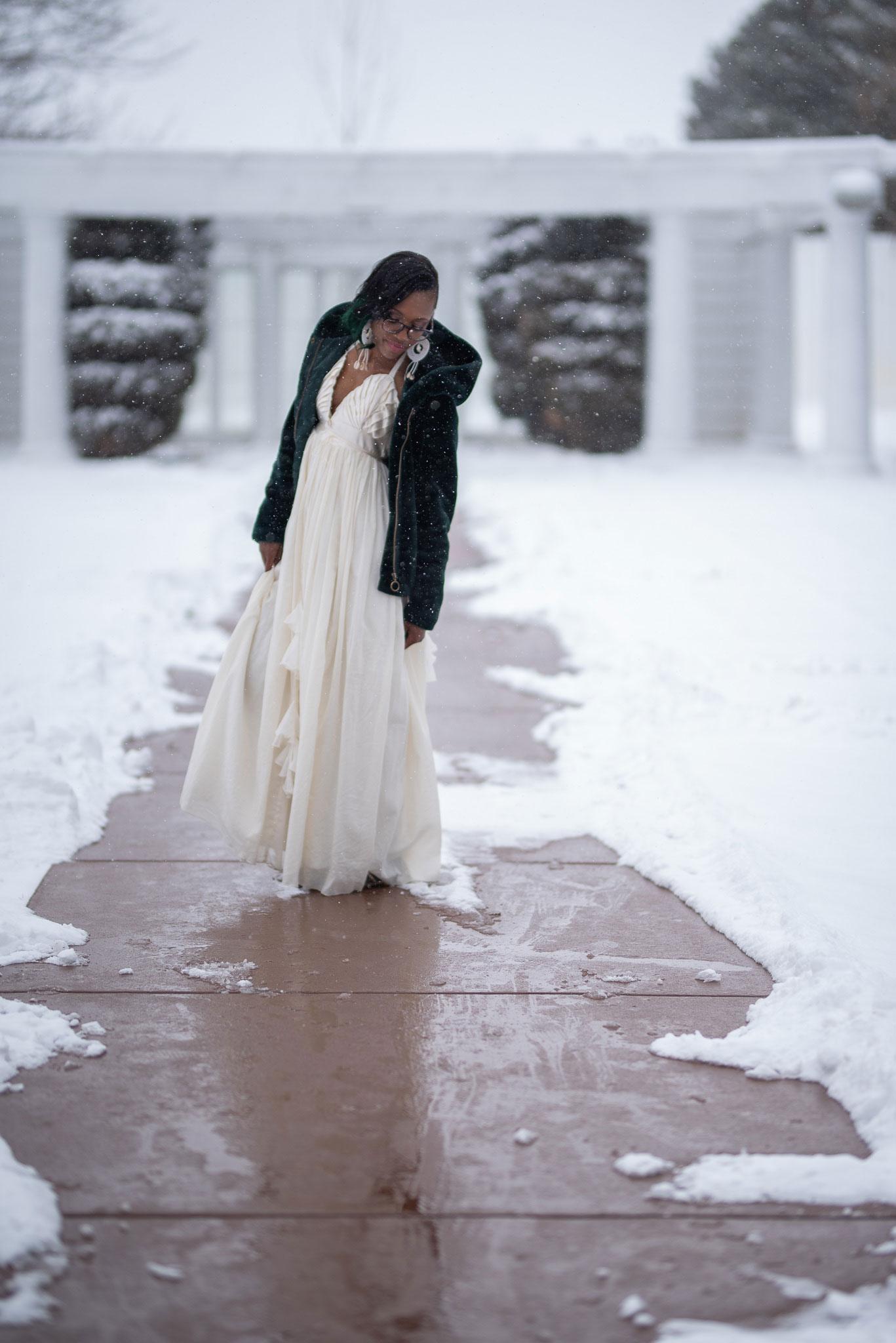 Bridal model in wedding dress in the snow at the Cannabis Wedding Expo in Denver, Colorado. Photo by Kenesha Facello.