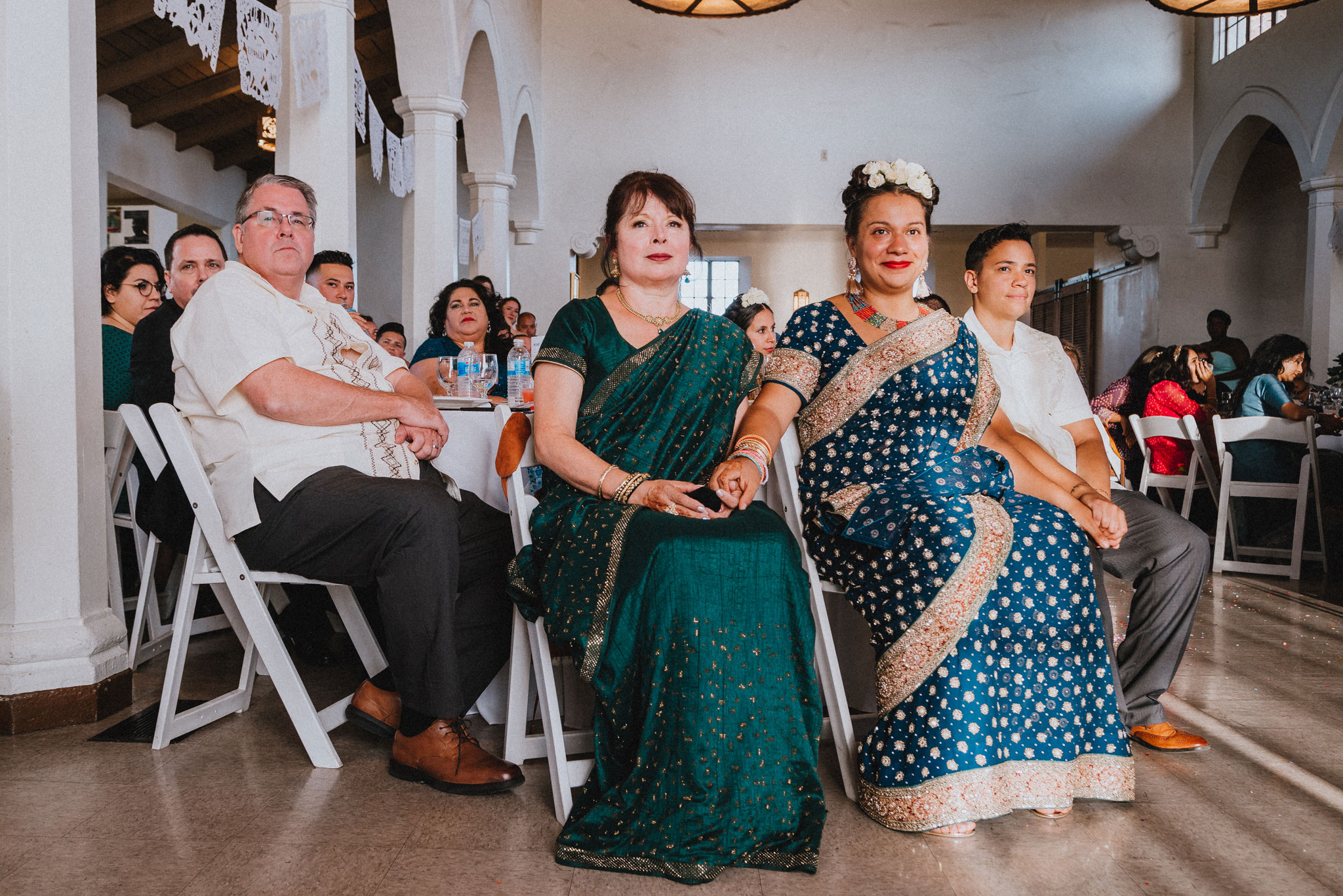 guests and family looking on at wedding reception by los angeles wedding photographer Rebecca y Las Otras