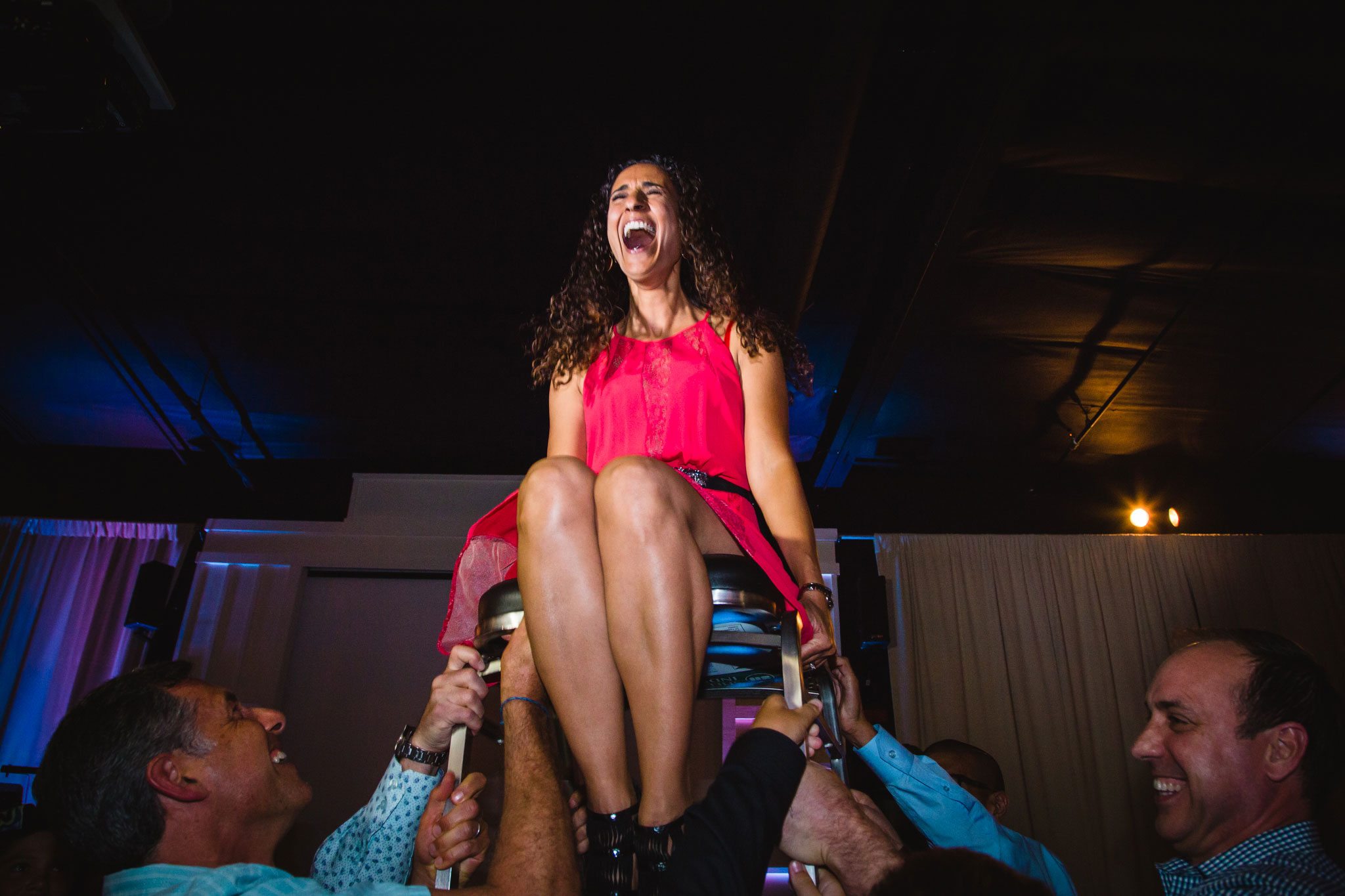 wedding reception with woman being raised up in a chair los angeles photographer Rebecca y Las Otras