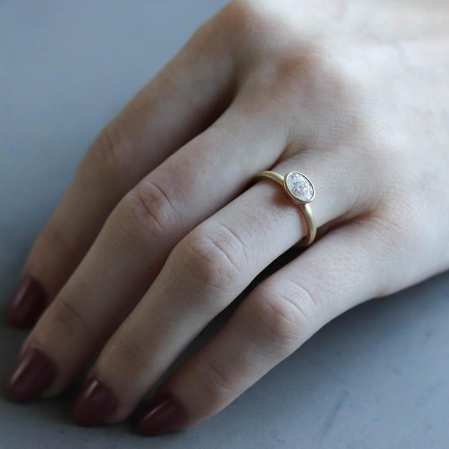 Bezel-set Oval Solitaire Engagement Ring by Aide-mémoire Jewelry