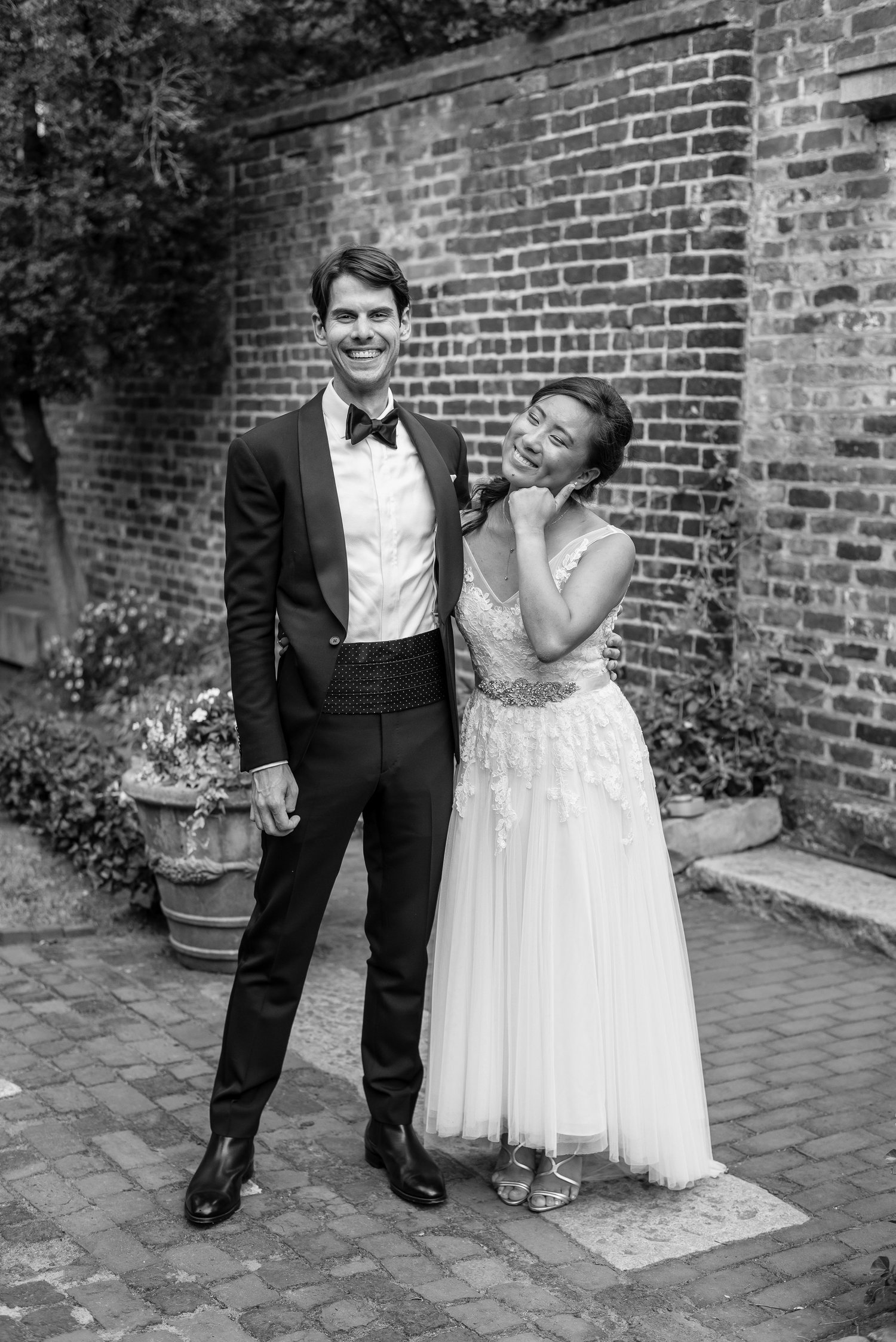 Ben and Christina smile after their wedding at the Poe Museum in Richmond Virginia