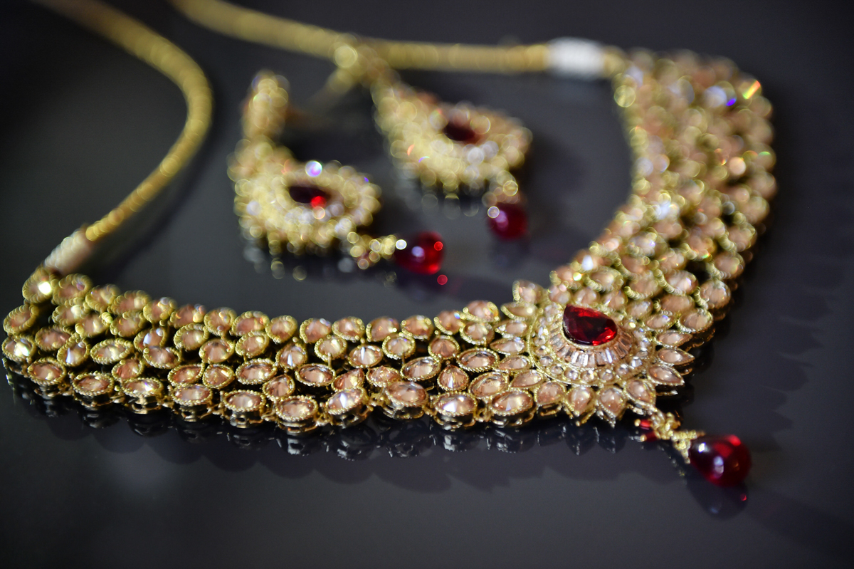 Mita's gold and red necklace for the Indian wedding ceremony in Hong Kong
