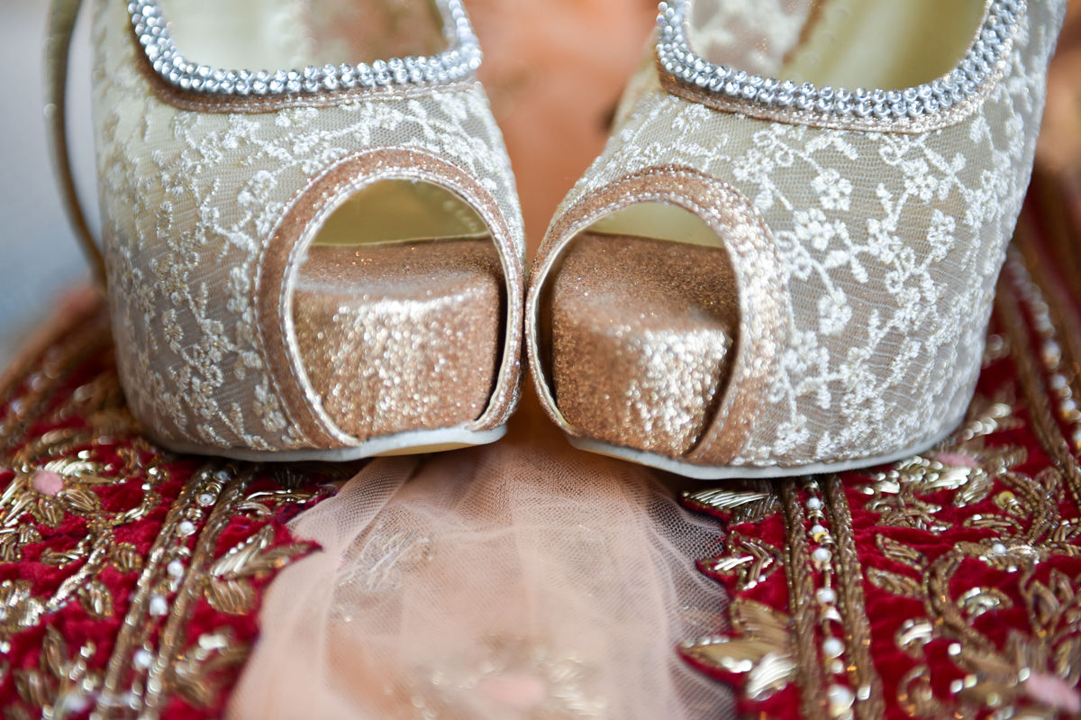 Mita's lace open toe pumps on top of her sari for their Indian wedding ceremony in Hong Kong