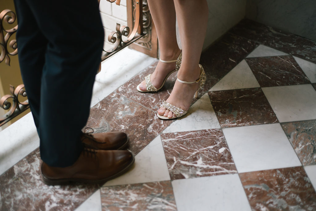 portland rainy elopement maddie maschger photography couple standing on checkered marble floor