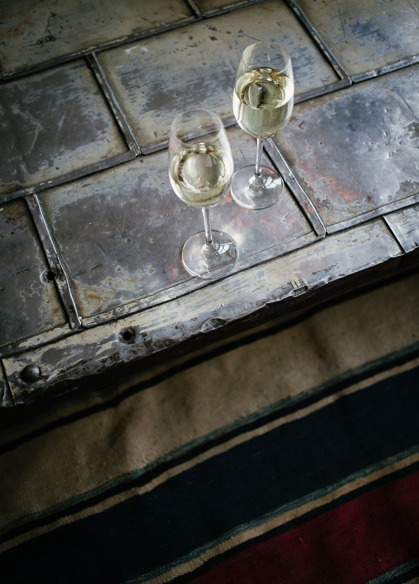 portland rainy elopement maddie maschger photography glasses of white wine on metal table