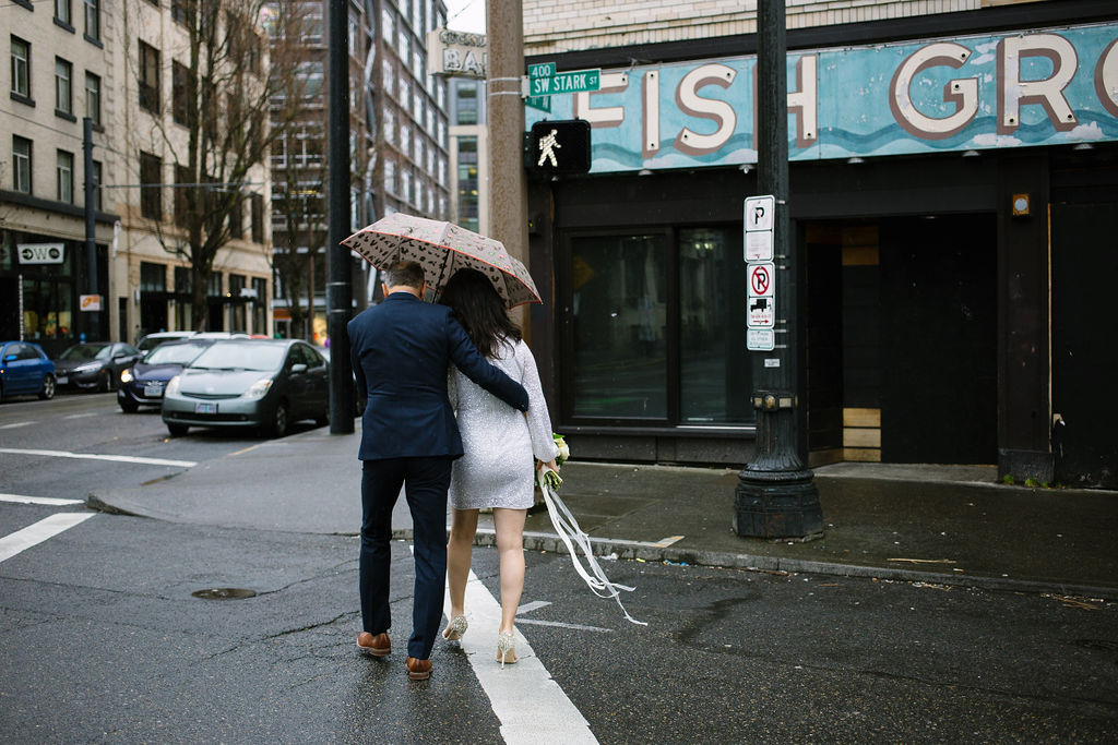 portland rainy elopement maddie maschger photography linda and moreno crossing rainy street with umbrella