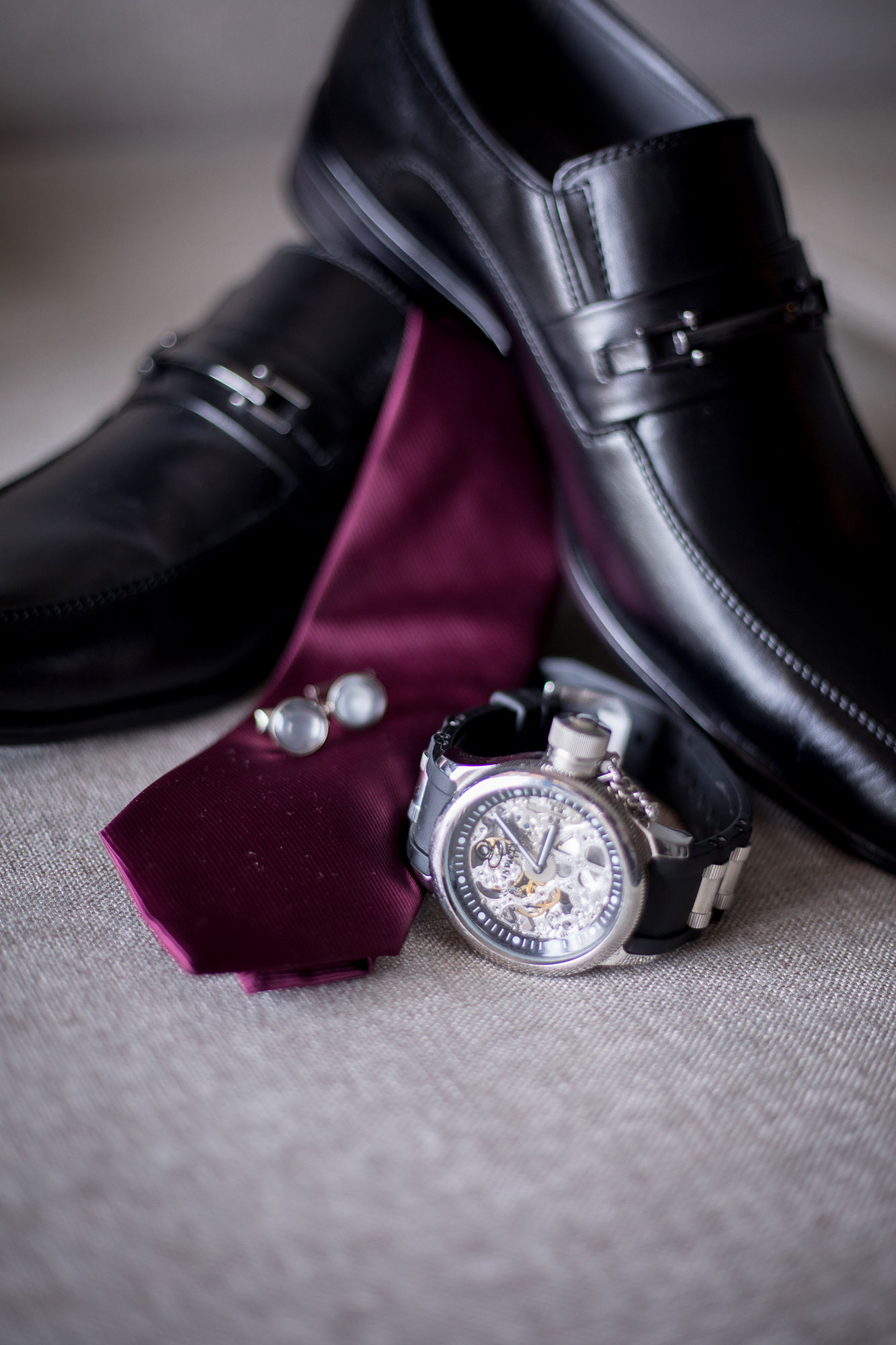 watch shoes tie and cufflinks while getting ready before wedding los angeles california Crystal lily photography