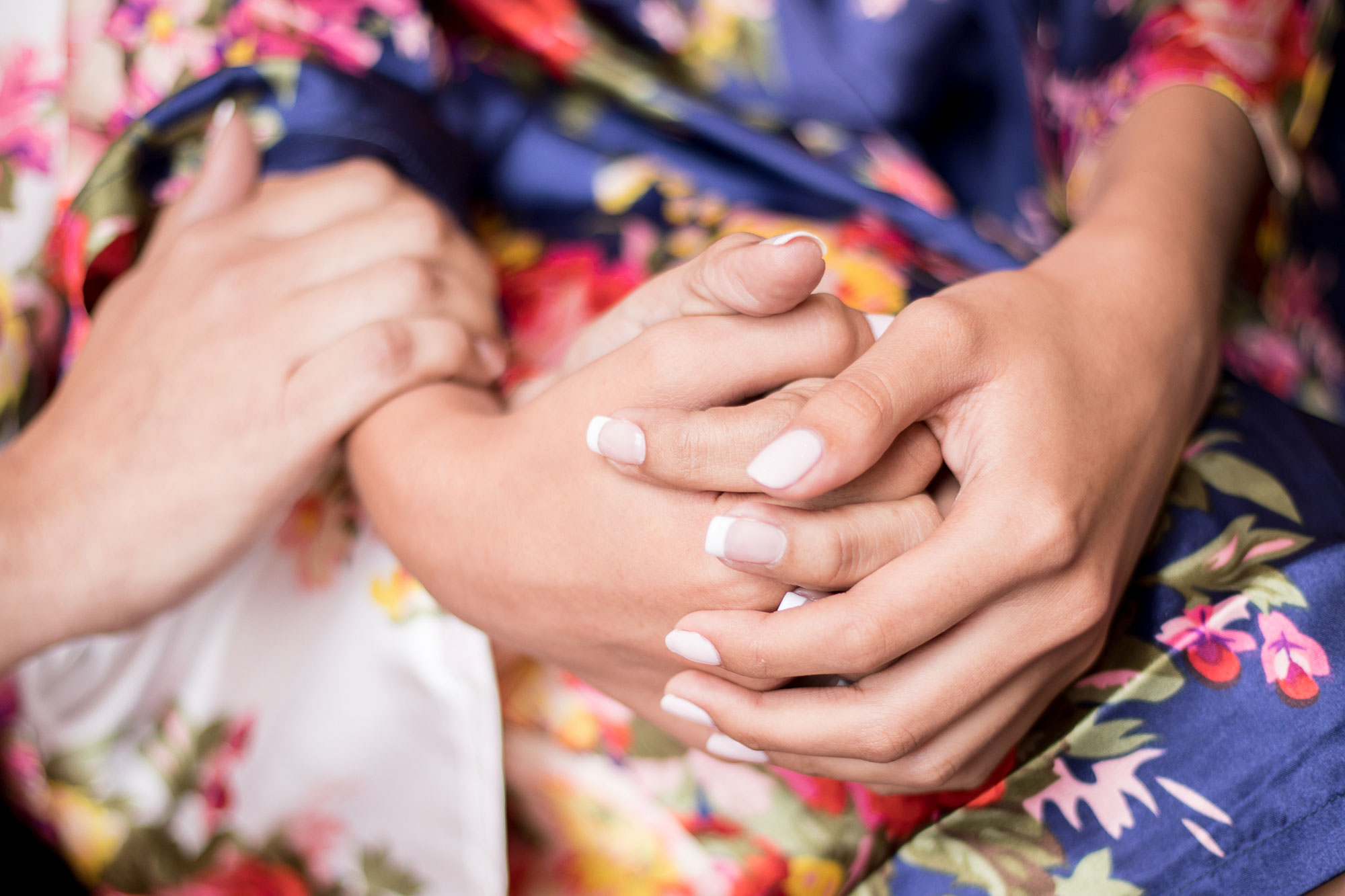bride holding hand of member of their wedding party while getting ready before ceremony los angeles crystal lily photography