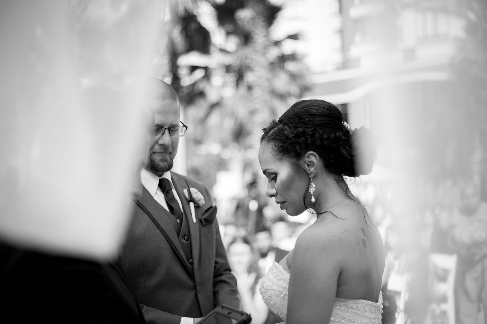 bride and groom sharing their vows at their wedding ceremony shot through the trees los angeles california crystal lily photography