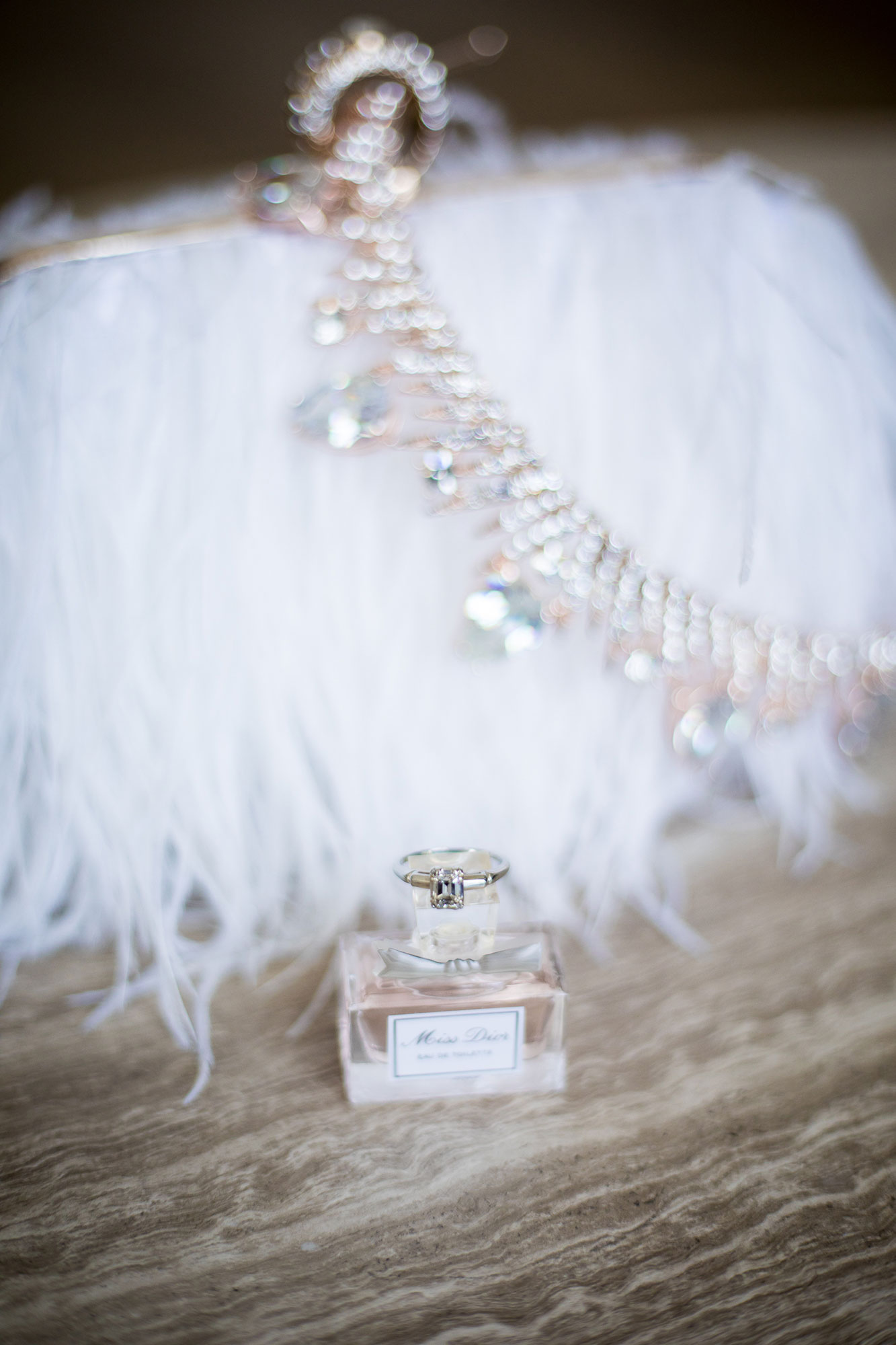 perfume and crystal crown draped over fur fringe clutch before wedding los angeles california crystal lily photography