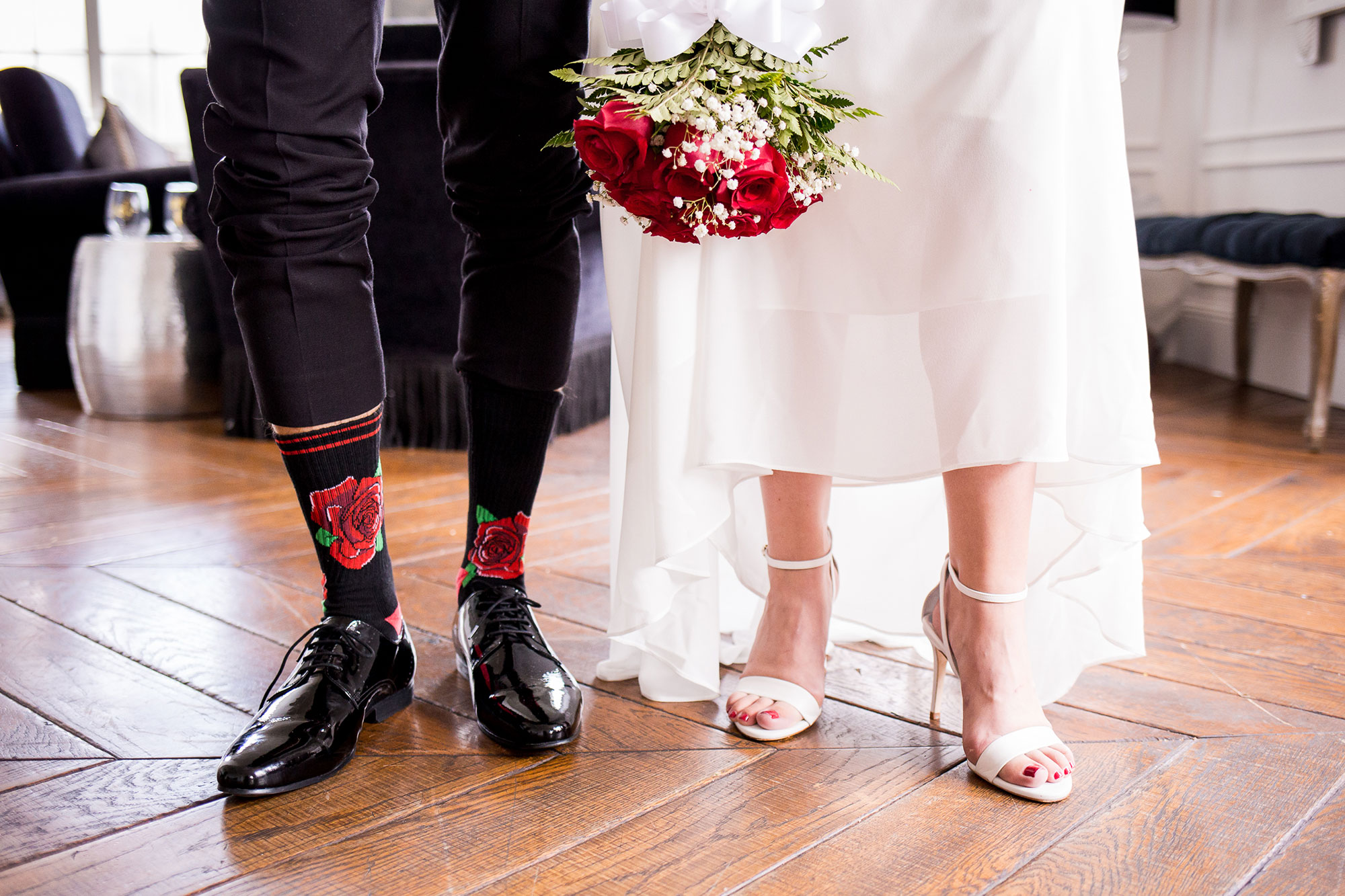 couple showing off there wedding shoes and grooms red rose high socks los angeles california crystal lily photography