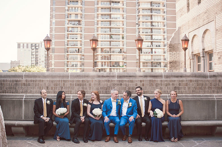 two groom smile at each other with their wedding party after their wedding Atlanta Georgia You Are Raven Wedding Photography