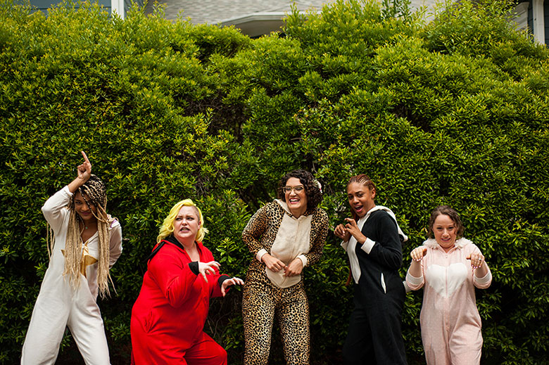 bride and wedding party dressed up in animal onesies before wedding Atlanta Georgia You Are Raven Wedding Photography