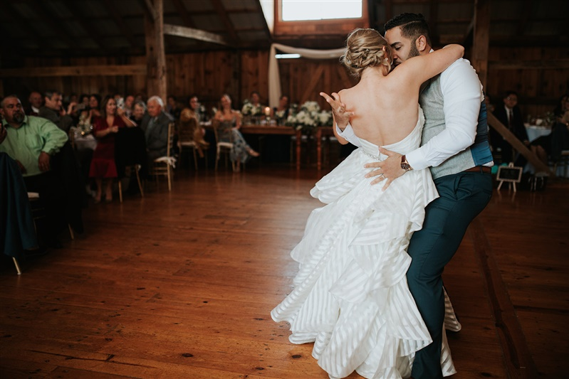 newlywed couple dancing at wedding reception in suit and striped flowing wedding dress richmond virginia carly romeo & Co.