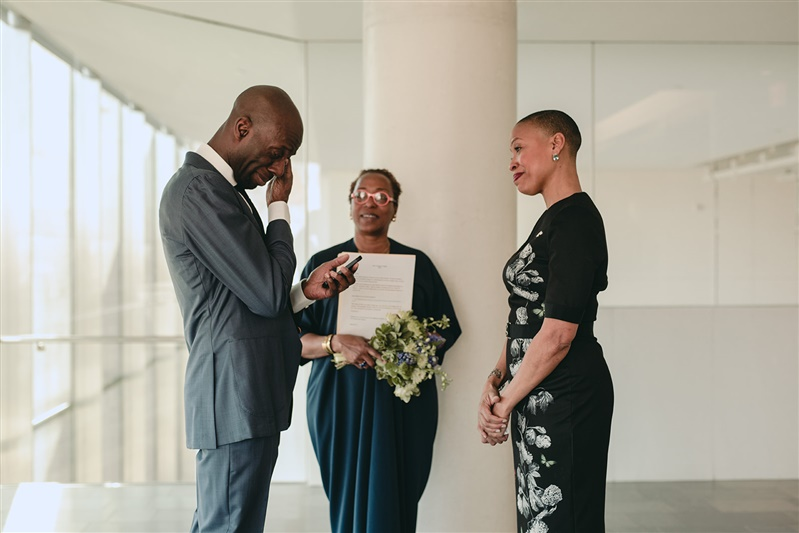 groom tearing up while reading vows during small elopement wedding ceremony in Richmond Virginia Carly Romeo & Co