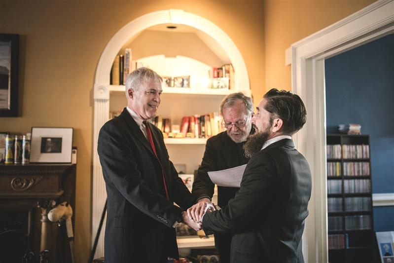 two grooms getting married at intimate at home ceremony Carly Romeo & Co Richmond Virginia