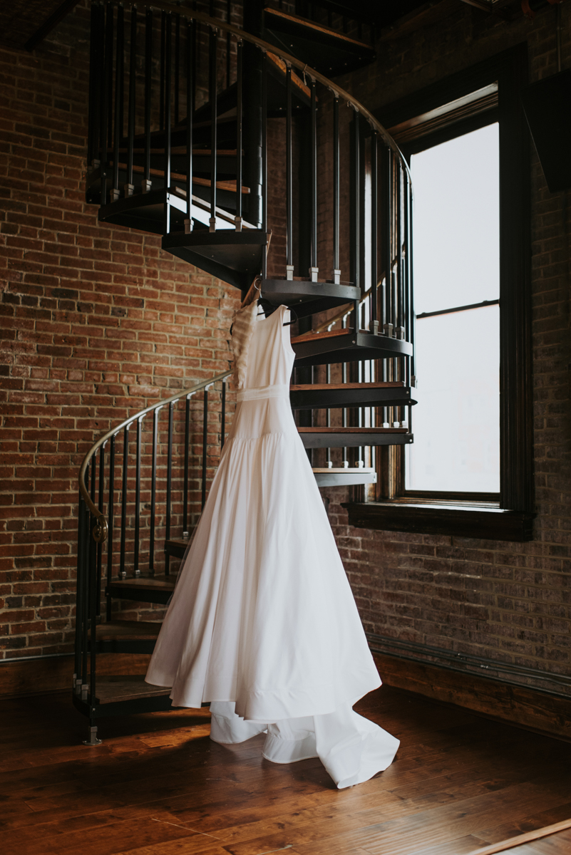 vintage vegan glam in Washington DC HFB Photography wedding dress hanging on spiral staircase