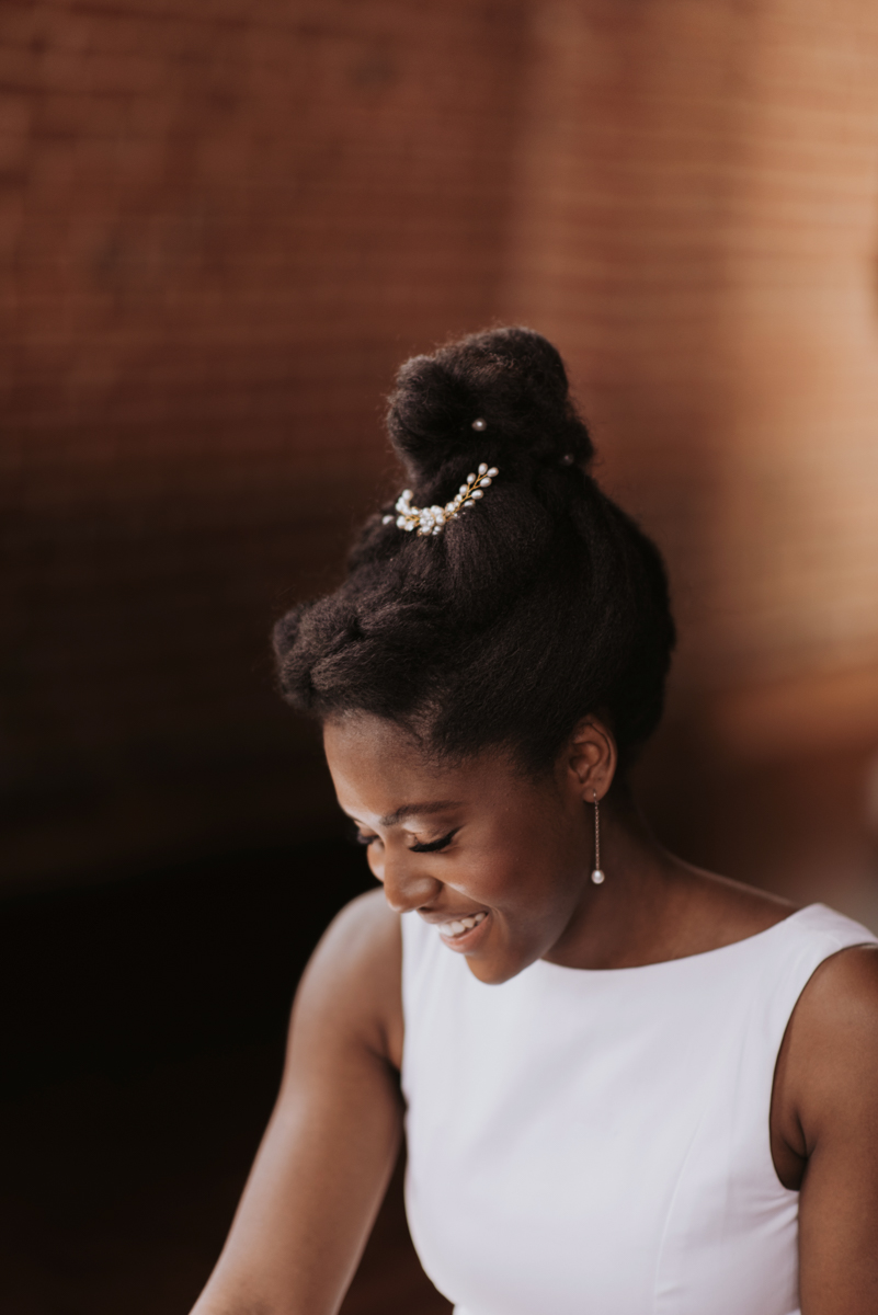 vintage vegan glam in Washington DC HFB Photography candid of bride in front of brick wall