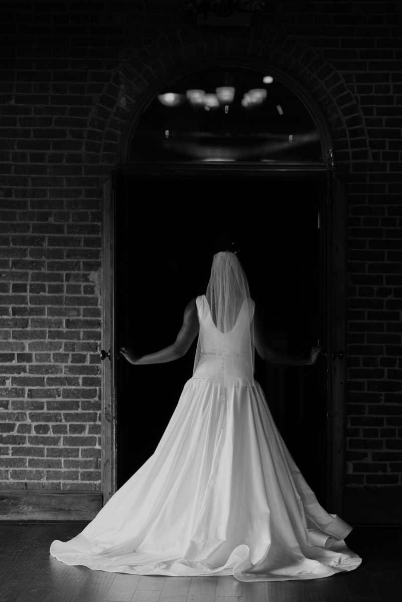 vintage vegan glam in Washington DC HFB Photography bride in doorway wearing dress and veil