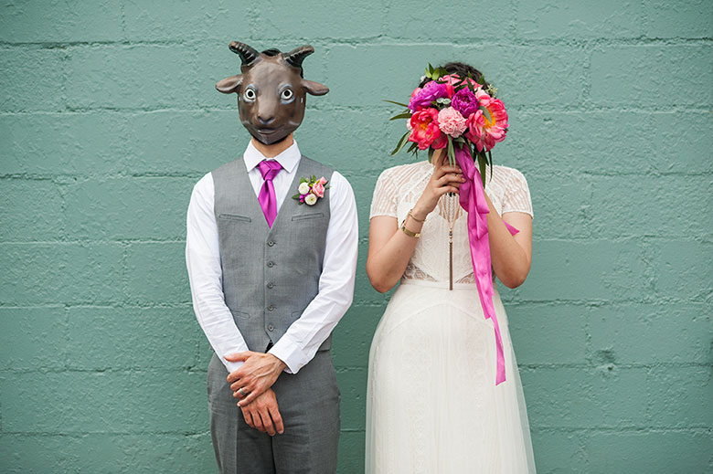 newlywed couple wearing animal mask and holding bouquet after wedding in Atlanta Georgia You Are Raven Wedding Photography
