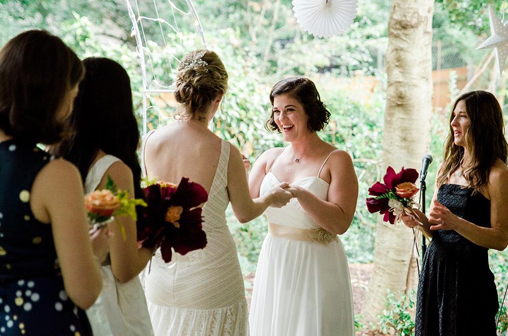 Lauren and Erin exchange vows at wedding ceremony Atlanta Georgia You Are Raven Wedding Photography
