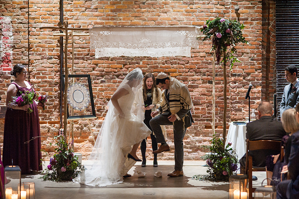Jewish couple breaks the glass during their wedding ceremony Atlanta Georgia You Are Raven Wedding Photography
