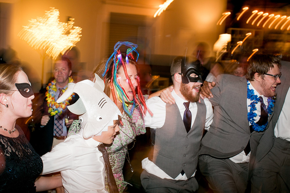 wedding guests in masks dance happily at the reception Atlanta Georgia You Are Raven Wedding Photography