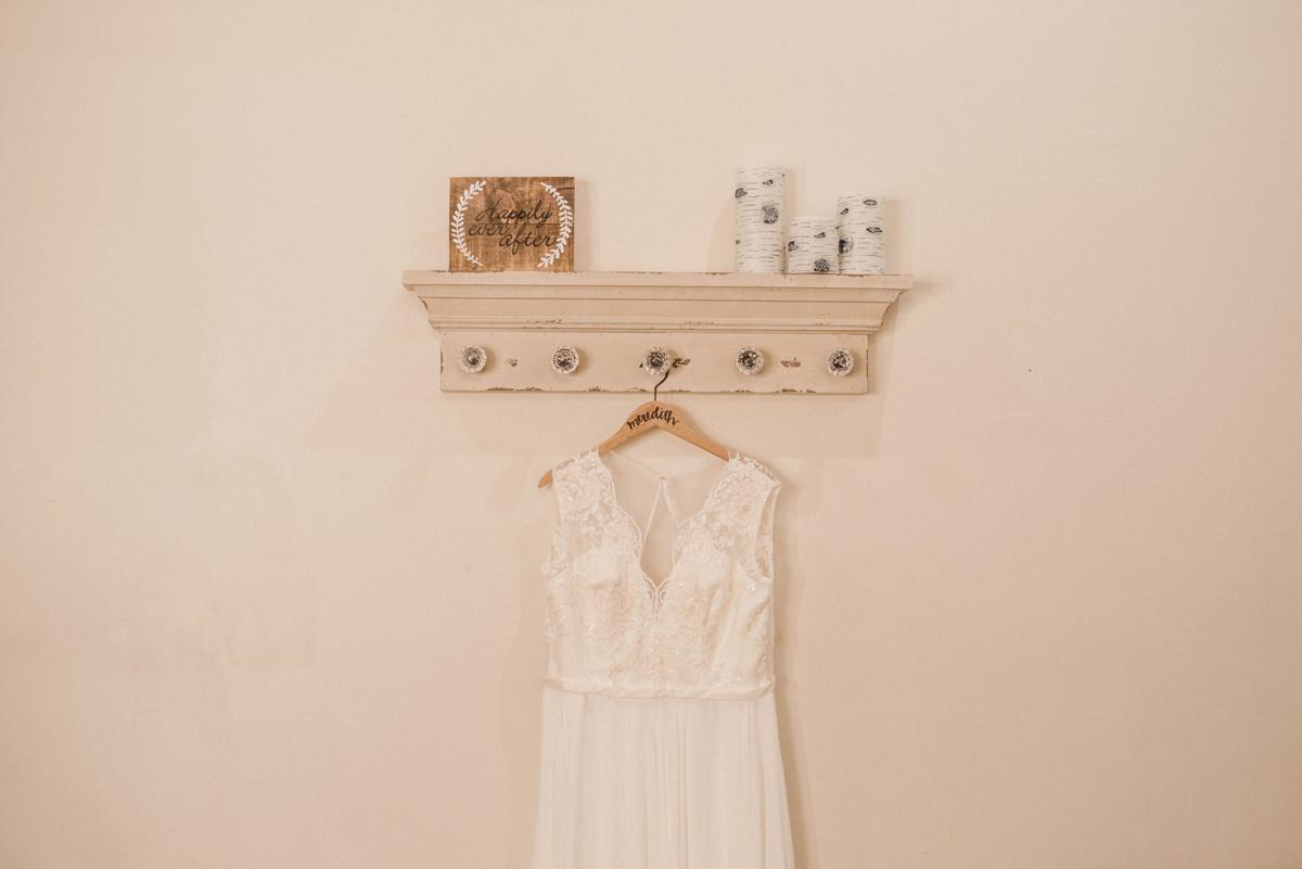 PAVILION WEDING KANSAS CITY MISSOURI Hey Tay Photography wedding dress hanging on shelf