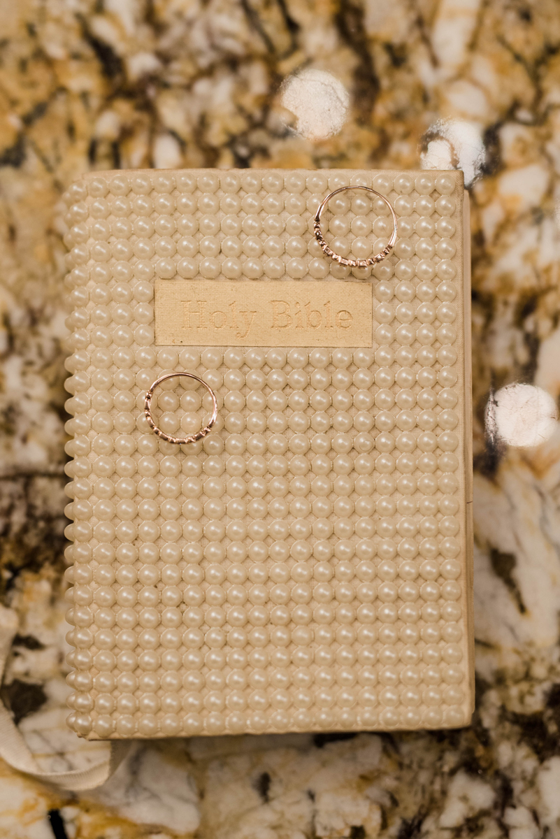 PAVILION WEDING KANSAS CITY MISSOURI Hey Tay Photography rings on pearl-cover bible