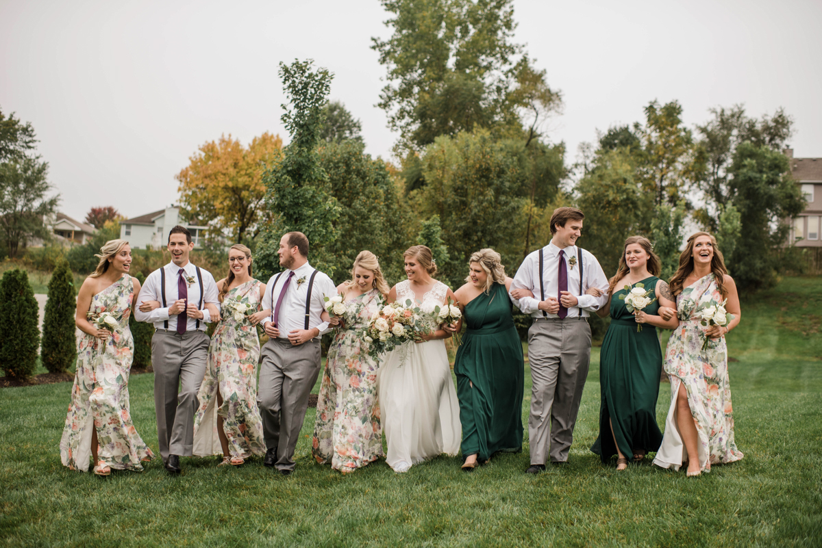 PAVILION WEDING KANSAS CITY MISSOURI Hey Tay Photography meredith's with some of wedding party linking arms