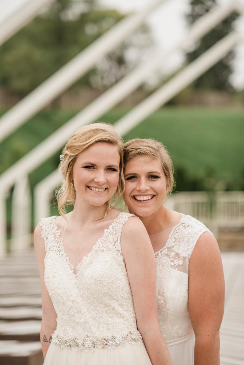 PAVILION WEDING KANSAS CITY MISSOURI Hey Tay Photography brides smiling