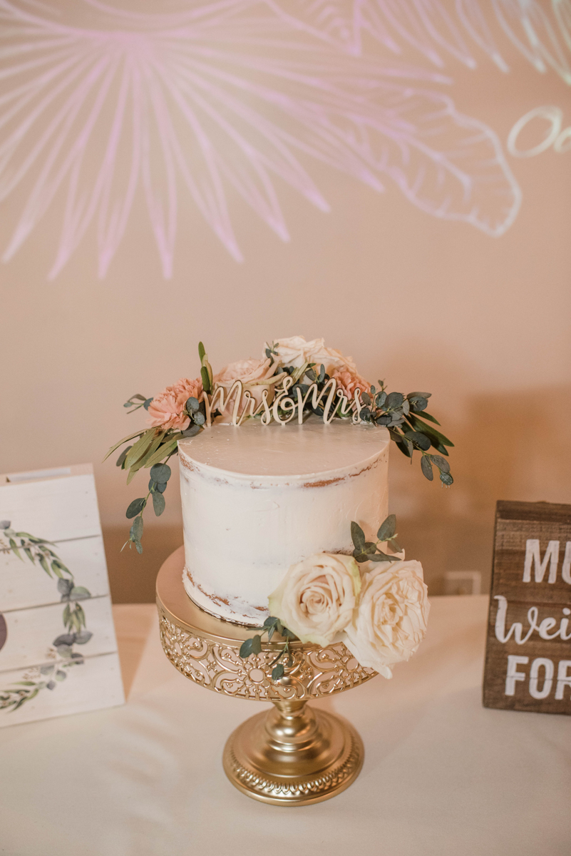 """PAVILION WEDING KANSAS CITY MISSOURI Hey Tay Photography cake decorated with roses and cake topper reading """"mrs. and mrs."""""""