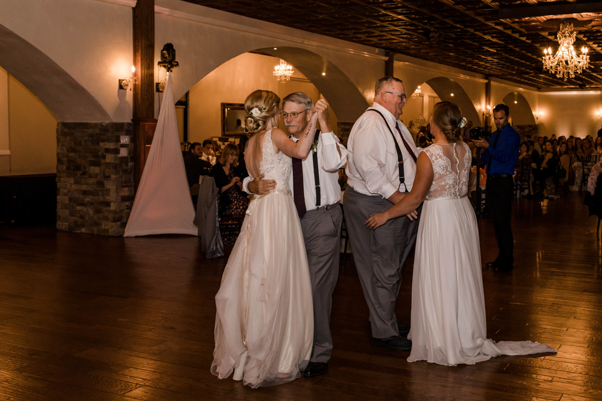 PAVILION WEDING KANSAS CITY MISSOURI Hey Tay Photography brides dancing with fathers-in-law