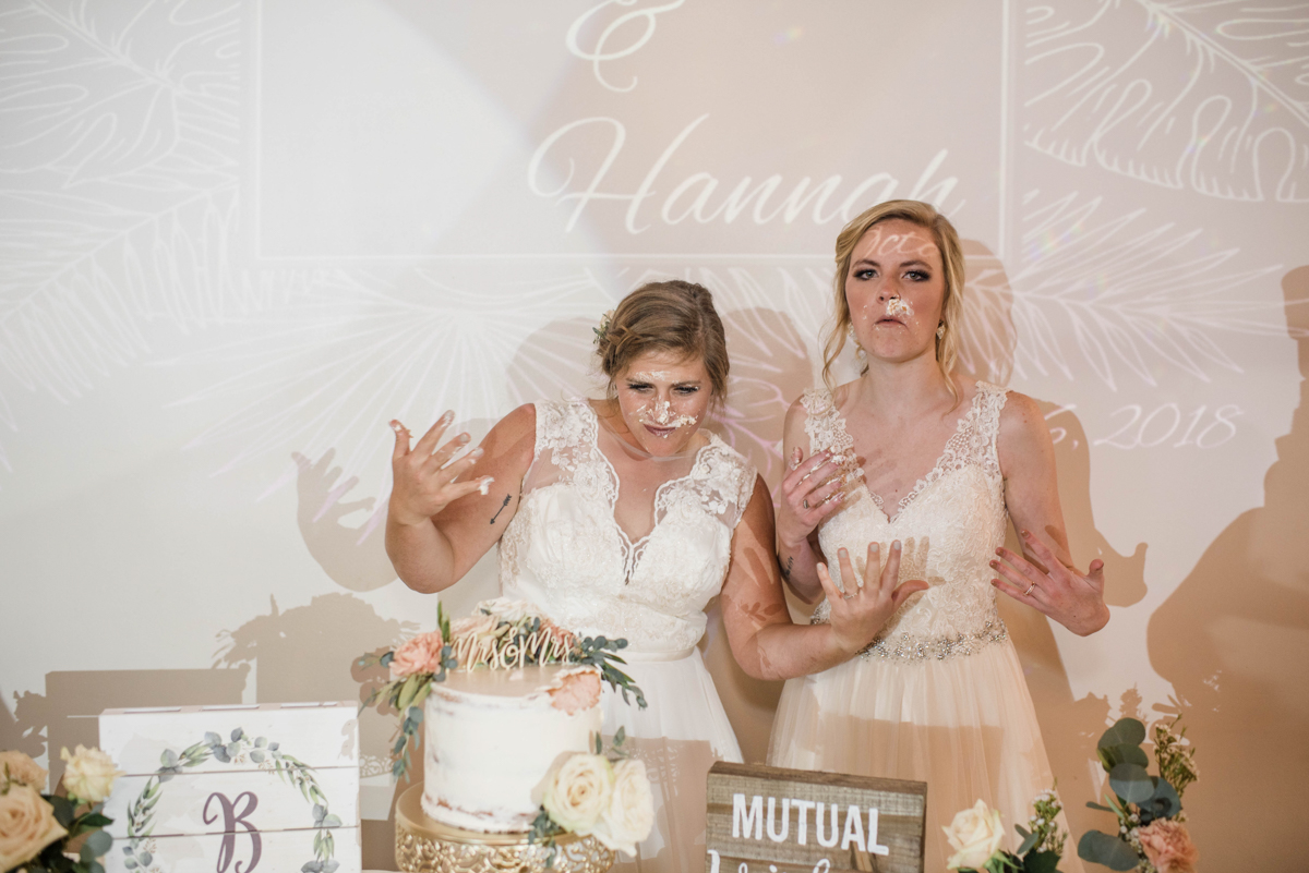 PAVILION WEDING KANSAS CITY MISSOURI Hey Tay Photography hannah and meredith with cake on their faces