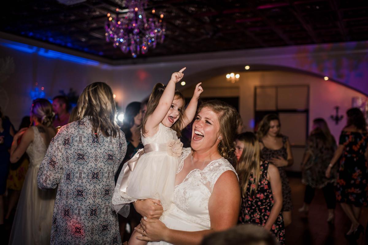 PAVILION WEDING KANSAS CITY MISSOURI Hey Tay Photography meredith holding flower girl on dance floor