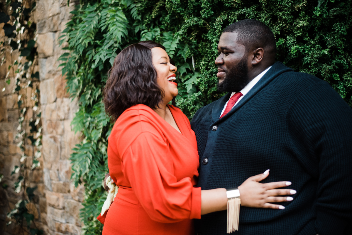 longwood gardens engagement kennett square pennsylvania sgw photography angelo and yasmine by brick wall with foliage