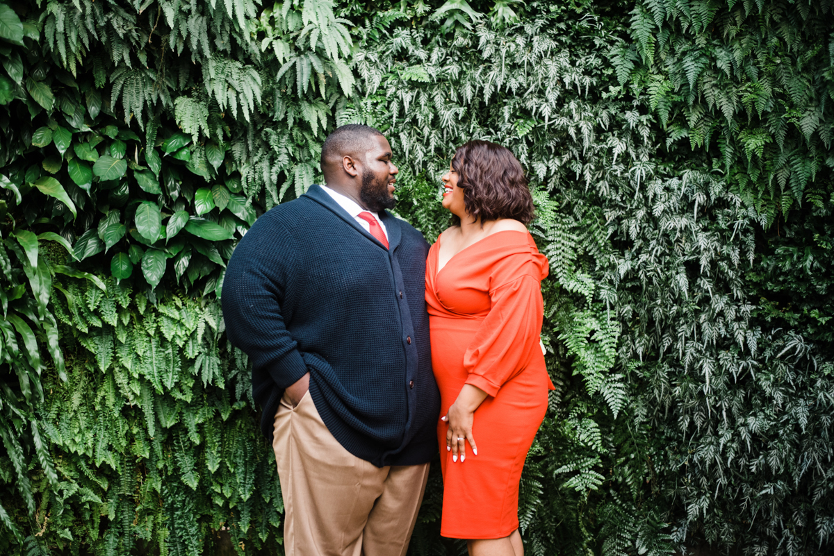 longwood gardens engagement kennett square pennsylvania sgw photography couple by foliage wall