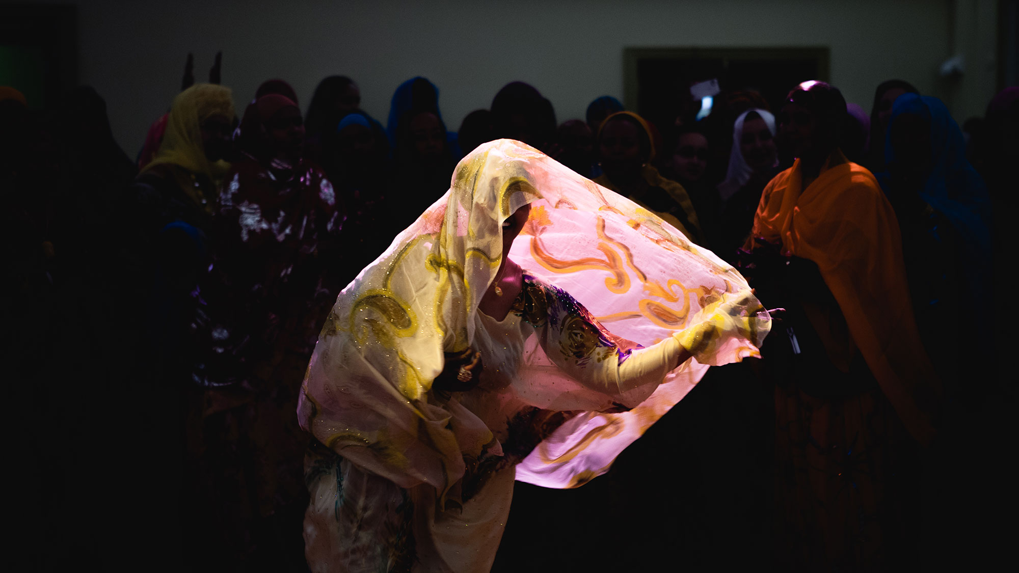 Somali woman dancing at wedding celebration by NYC photographer and videographer Elizabeth Mealey
