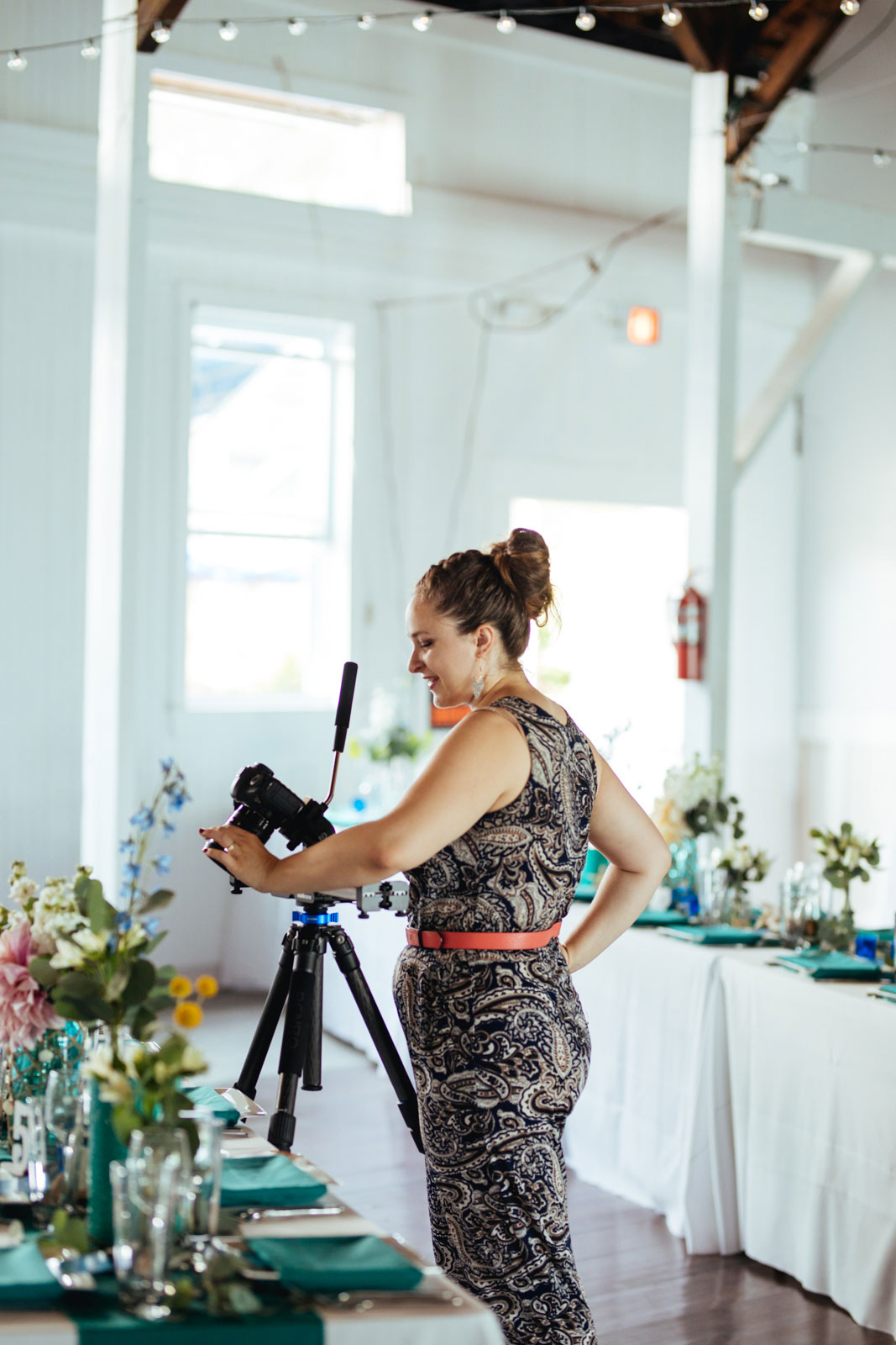 NYC wedding photographer and videographer Elizabeth Mealey adjusting the camera while filming a wedding