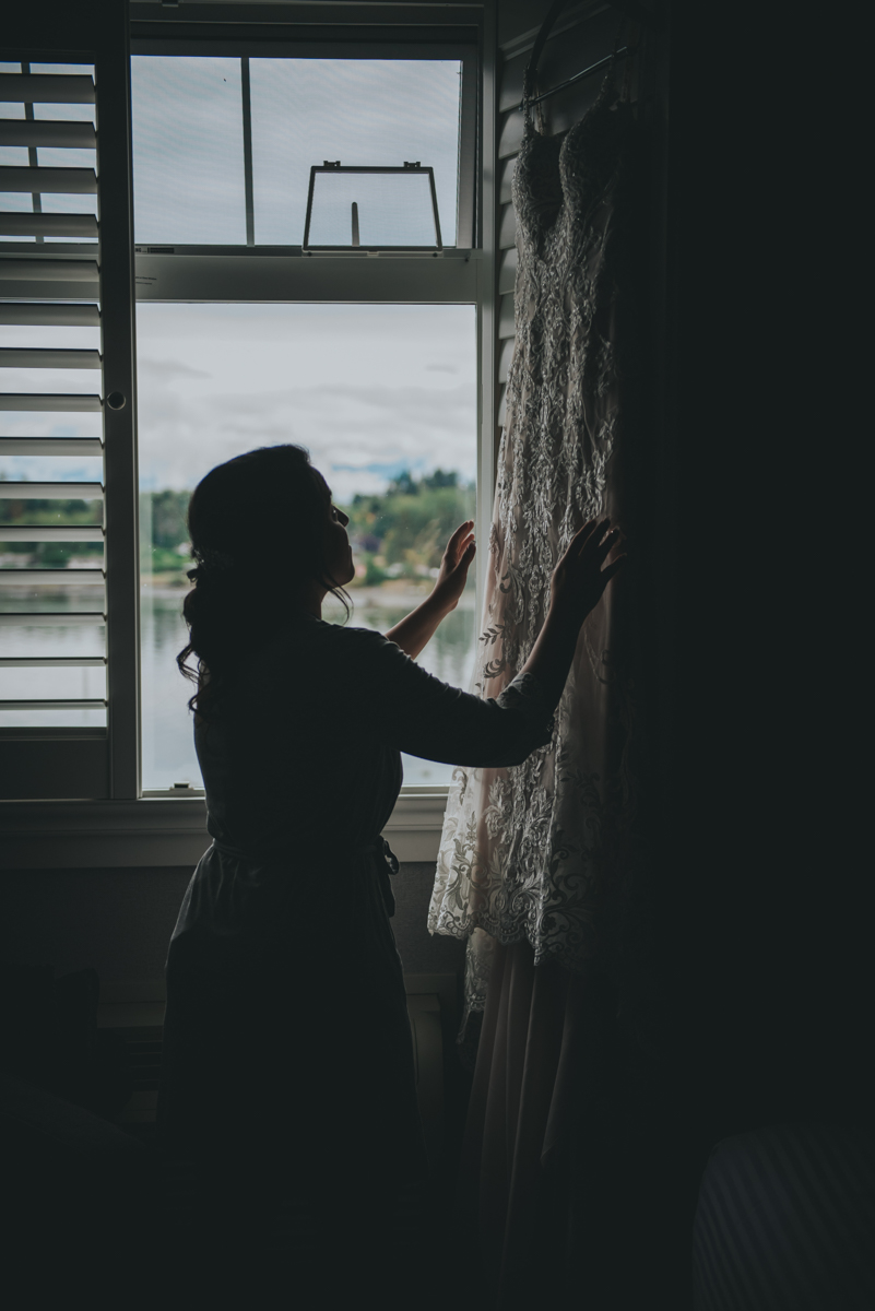 Persian-Canadian Wedding Innocent Thunder Photography Sooke Victoria Canada golly with dress hanging by window