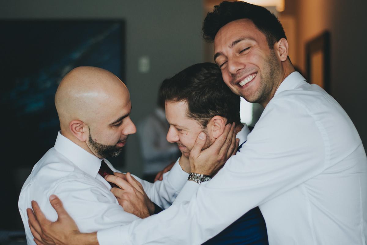 Persian-Canadian Wedding Innocent Thunder Photography Sooke Victoria Canada amin and groomsmen in group hug