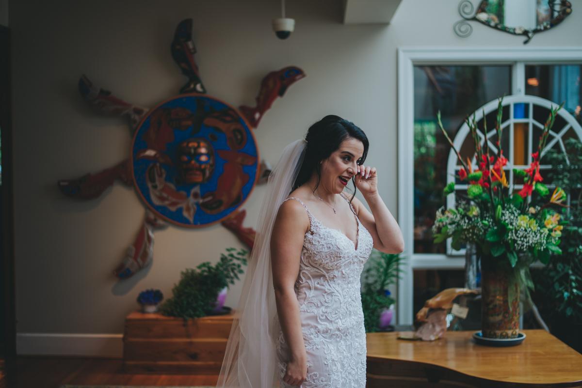 Persian-Canadian Wedding Innocent Thunder Photography Sooke Victoria Canada golly wiping tear