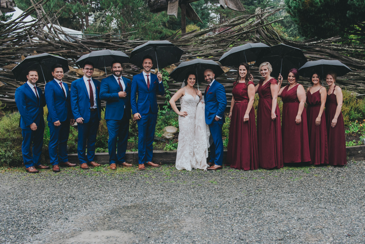 Persian-Canadian Wedding Innocent Thunder Photography Sooke Victoria Canada wedding party outside holding umbrellas
