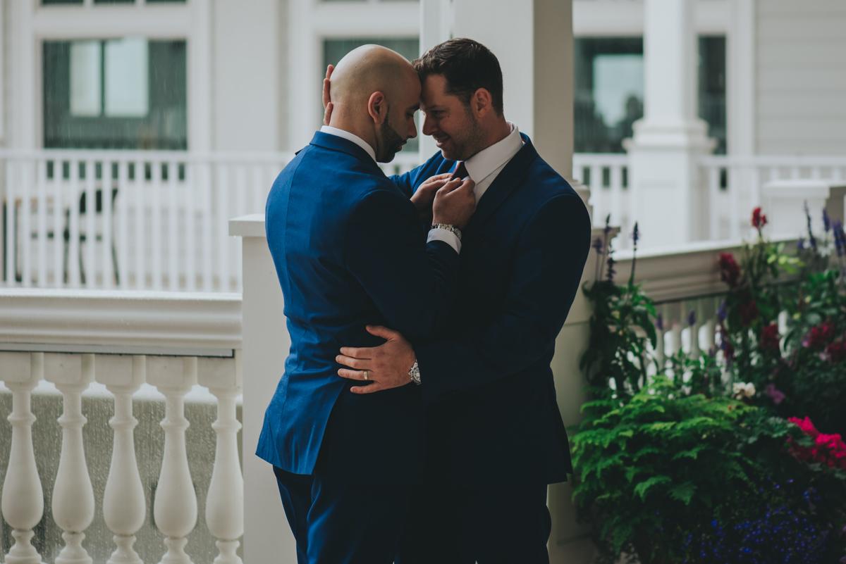 Persian-Canadian Wedding Innocent Thunder Photography Sooke Victoria Canada amin tying groomsman's tie