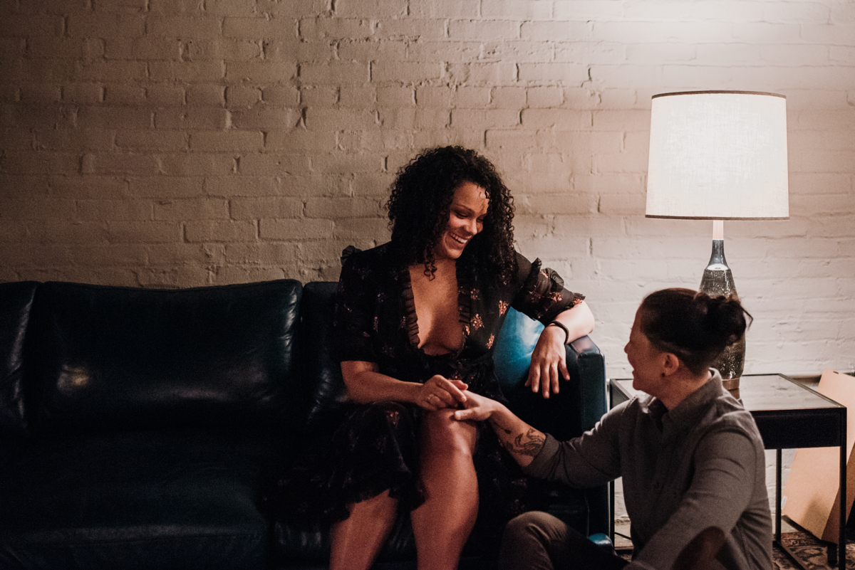 surprise proposal wm. mulherin's sons hotel philadelphia pennsylvania lauren driscoll photography kimberly on couch, ashley on floor, couple holding hands