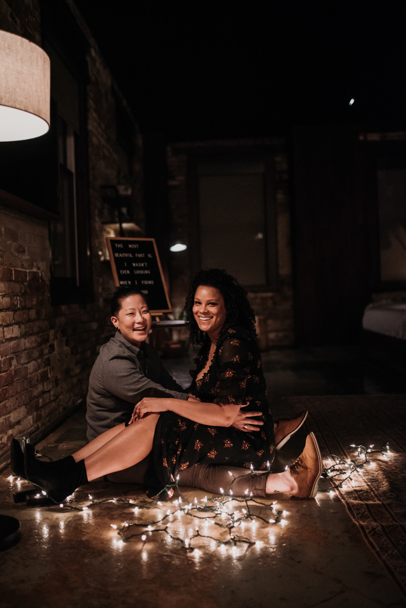 surprise proposal wm. mulherin's sons hotel philadelphia pennsylvania lauren driscoll photography kimberly and ashley sitting on floor with string lights