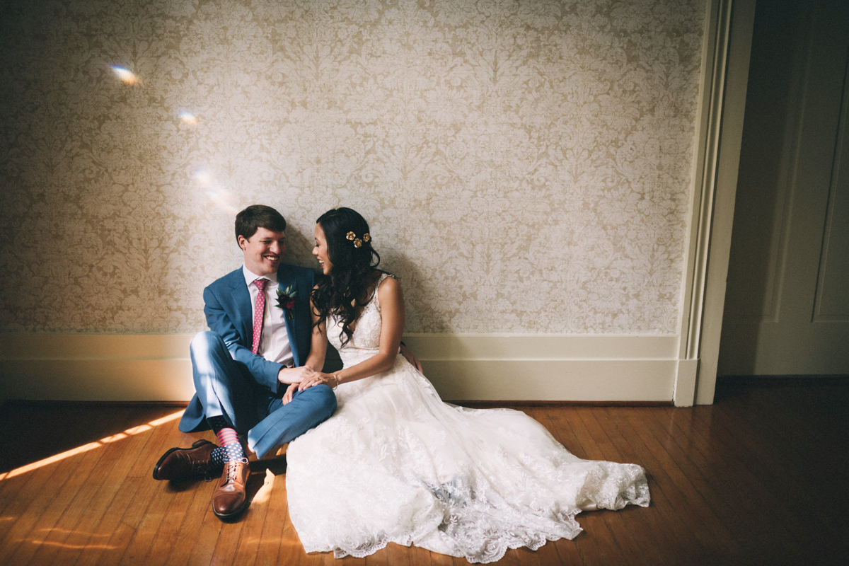 Warrenwood manor danville kentucky wedding sarah katherine davis couple sitting on wood floor of manor
