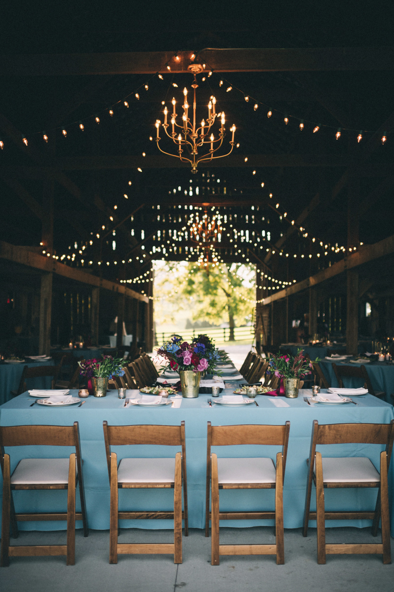 Warrenwood manor danville kentucky wedding sarah katherine davis renovated barn with tables and string lights
